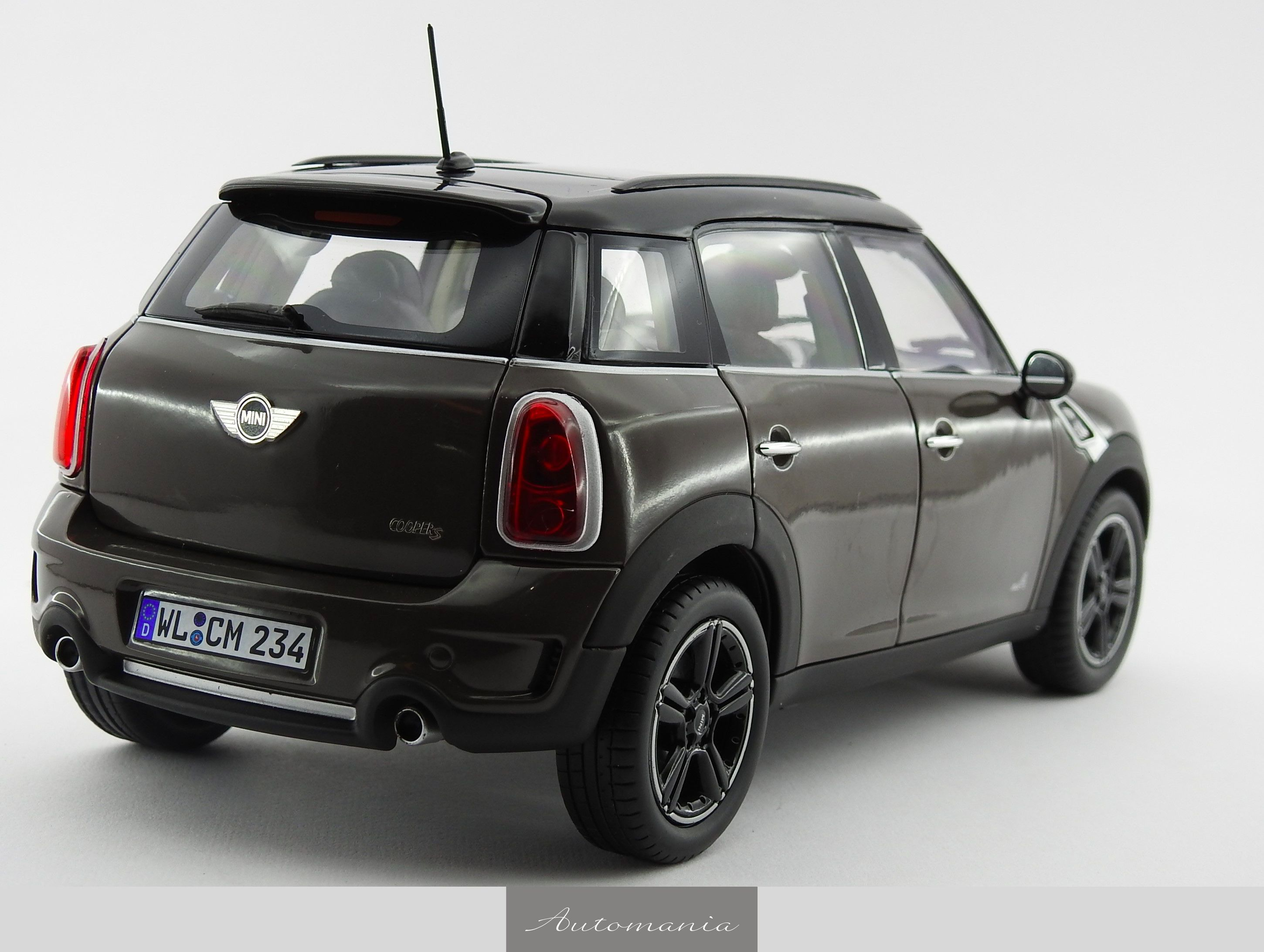 mini cooper cooper s country man 2010 brown black automania. Black Bedroom Furniture Sets. Home Design Ideas